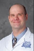Dr. Christian J. Mustill, MD