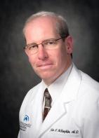 Dr. John A. McLaughlin, MD