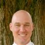 Dr. Travis F. Wiggins, MD