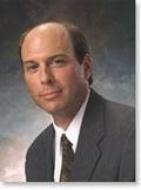 Dr. John E Bitner