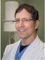 Tom M Porter, MD