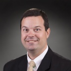 Dr. Cyrus Caroom, MD