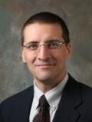 Anthony M De Beus, MD