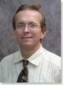 Dr. Randolph E. Schumacher, MD