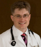 Dr. Eugene F. Tharalson, MD