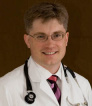 Dr. Eugene F. Tharalson, MD
